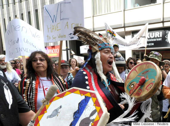 Nadleh Whut'en Chief Martin Louie (R) joins protesters outside the Enbridge Inc. annual general meeting of shareholders in Toronto May 9, 2012.  The Yinka Dene Alliance is comprised of First Nations members who are opposed to Stephen Harper government's stated intention to push through with the proposed Enbridge Northern Gateway pipelines and tankers project, in violation of First Nations' constitutionally-protected rights.  REUTERS/ Mike Cassese (CANADA - Tags: CIVIL UNREST BUSINESS ENVIRONMENT ENERGY)